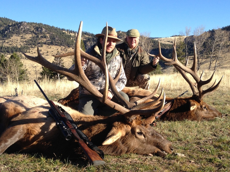 Two hunters with large elk