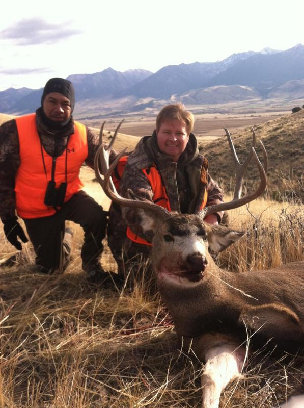 Two hunters with a large deer
