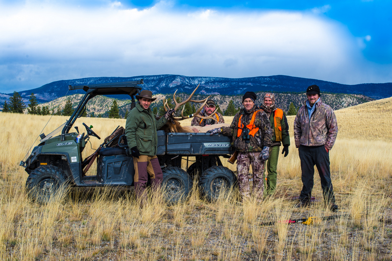 Group of hunters with large elk